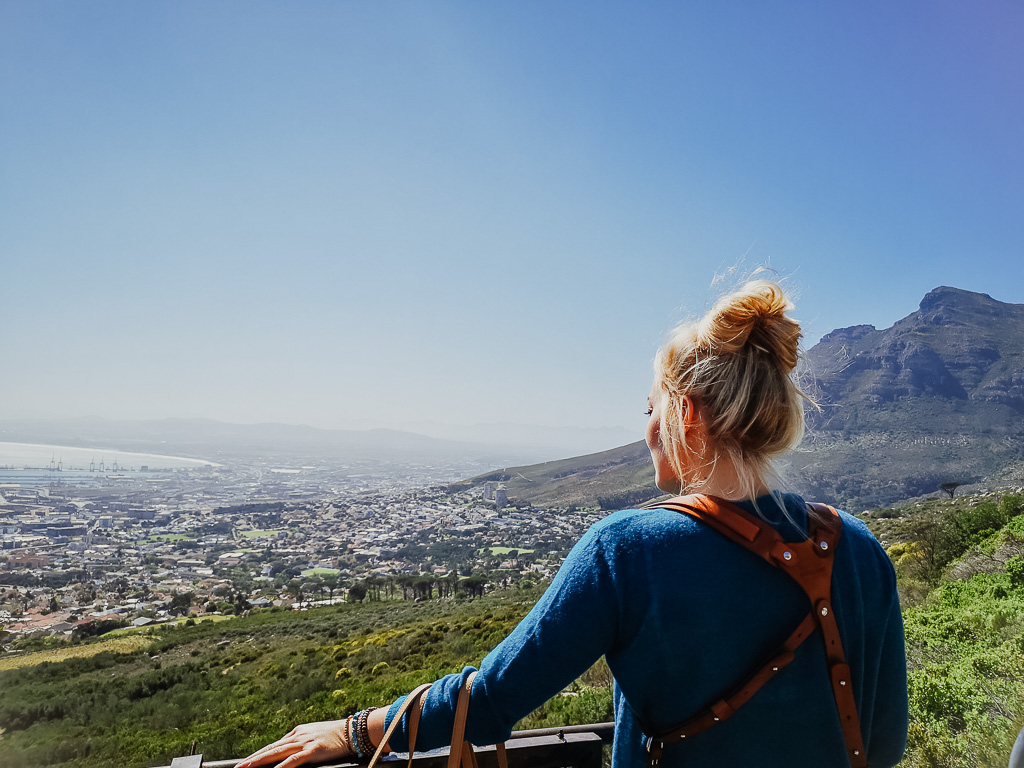 woman traveling solo looking at table mountain
