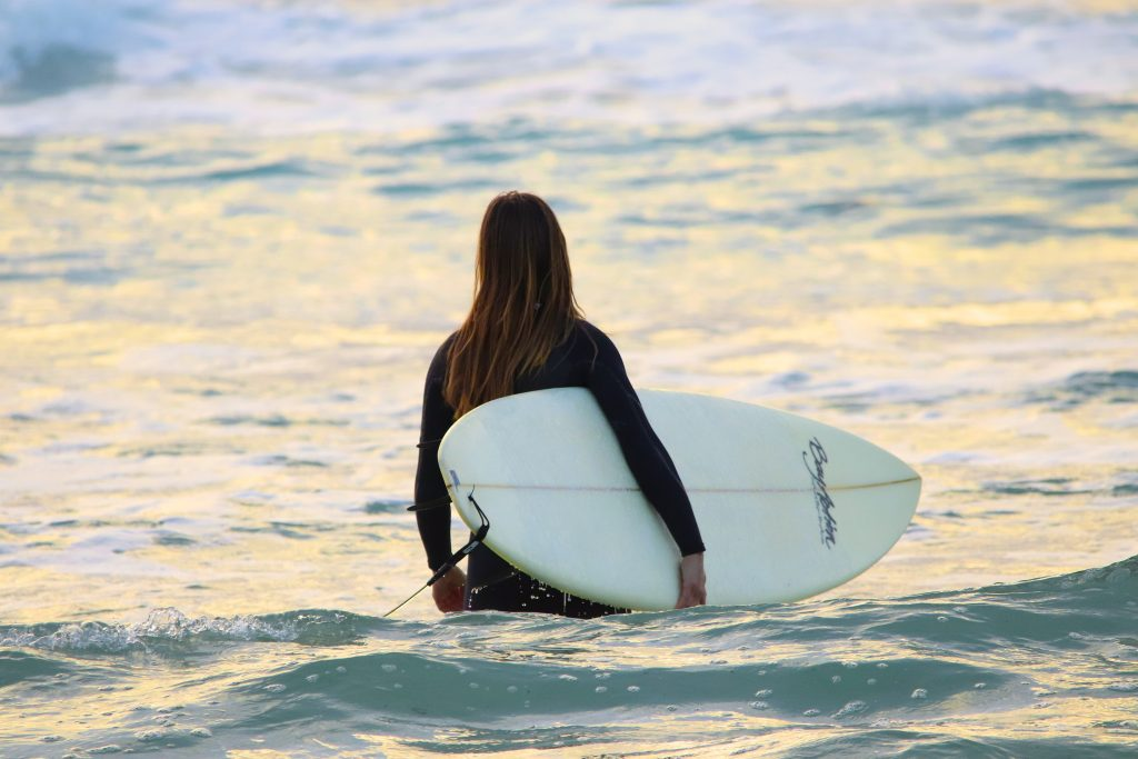 solo female traveling surfing in bali