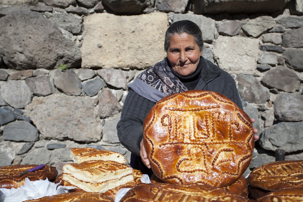 woman holding bread fro solo female travelers